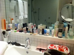 CLUTTERED AND DISORGANIZED SMALL BATHROOM WITH REGULAR MIRROR