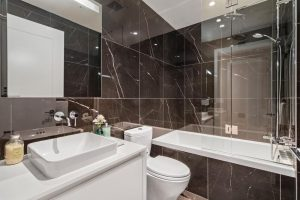 SMALL BATHROOM WITH RECESSED SIDLER DIAMANDO LIT MIRRORED CABINET - HEATHER & SEVENTEENTH, VANCOUVER, BC